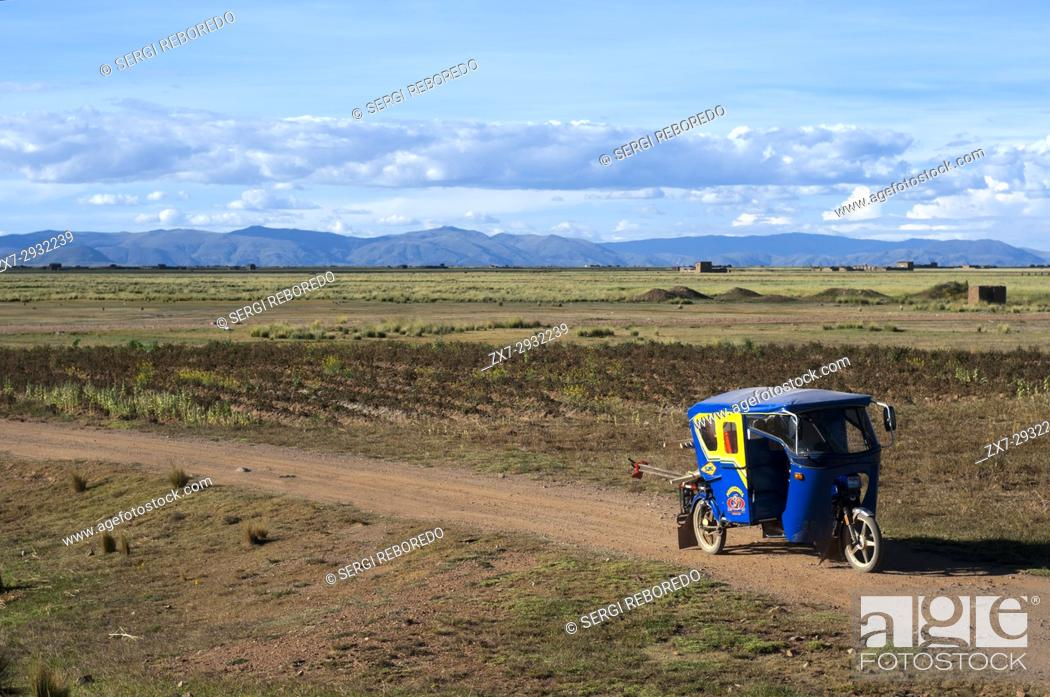 Stock Photo: Tuc tuc in the Peruvian altiplano landscape seen from inside the Andean Explorer train Orient Express which runs between Cuzco and Puno.