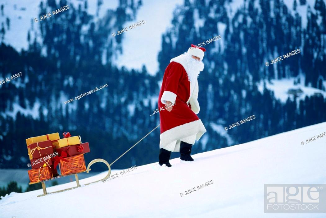 Stock Photo: Santa Claus pulling sled.