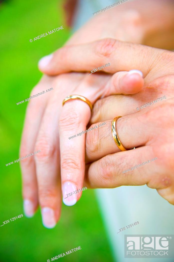 Stock Photo: Wedding rings on each other's hands.