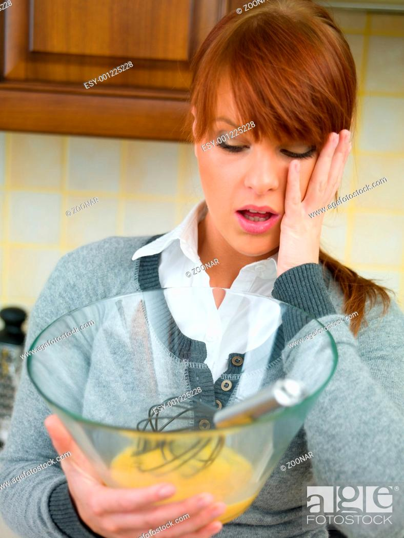 Stock Photo: Woman in Kitchen.