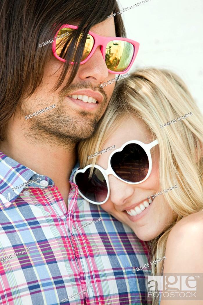 Stock Photo: Young couple wearing sunglasses.