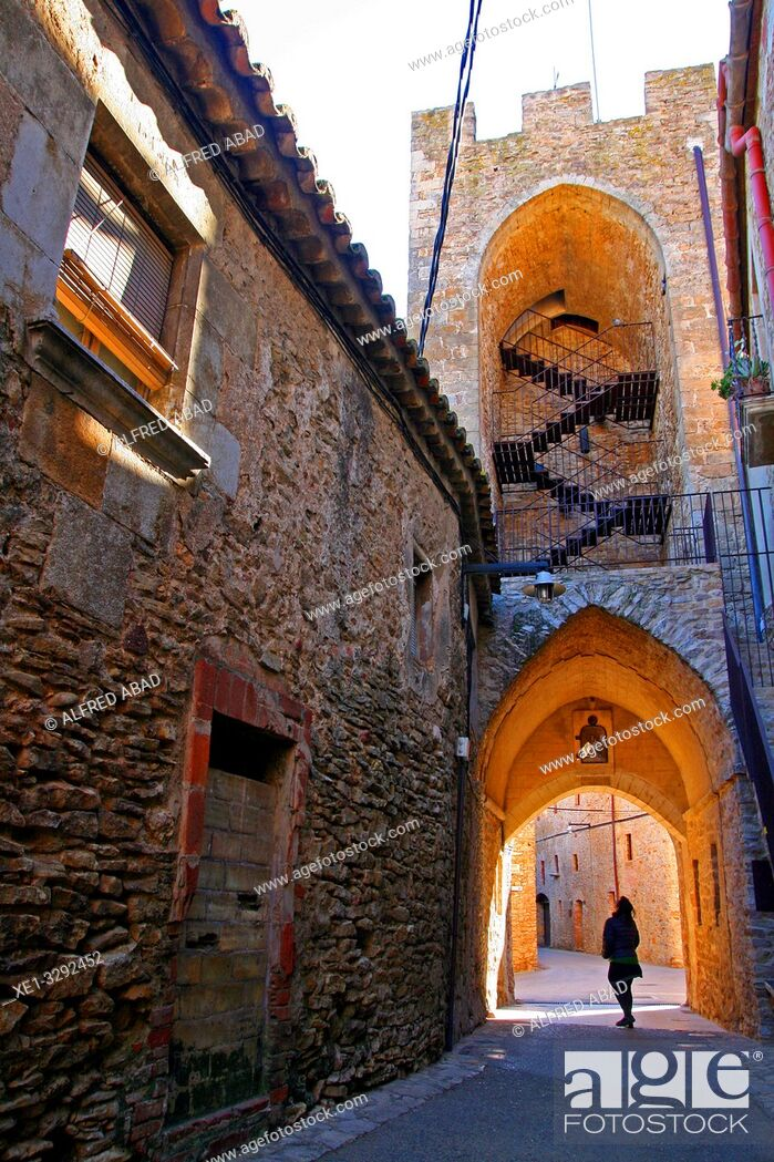 Stock Photo: street and tower of the old castle, Palau-Sator, Baix Empordà, Girona, Catalonia, Spain.