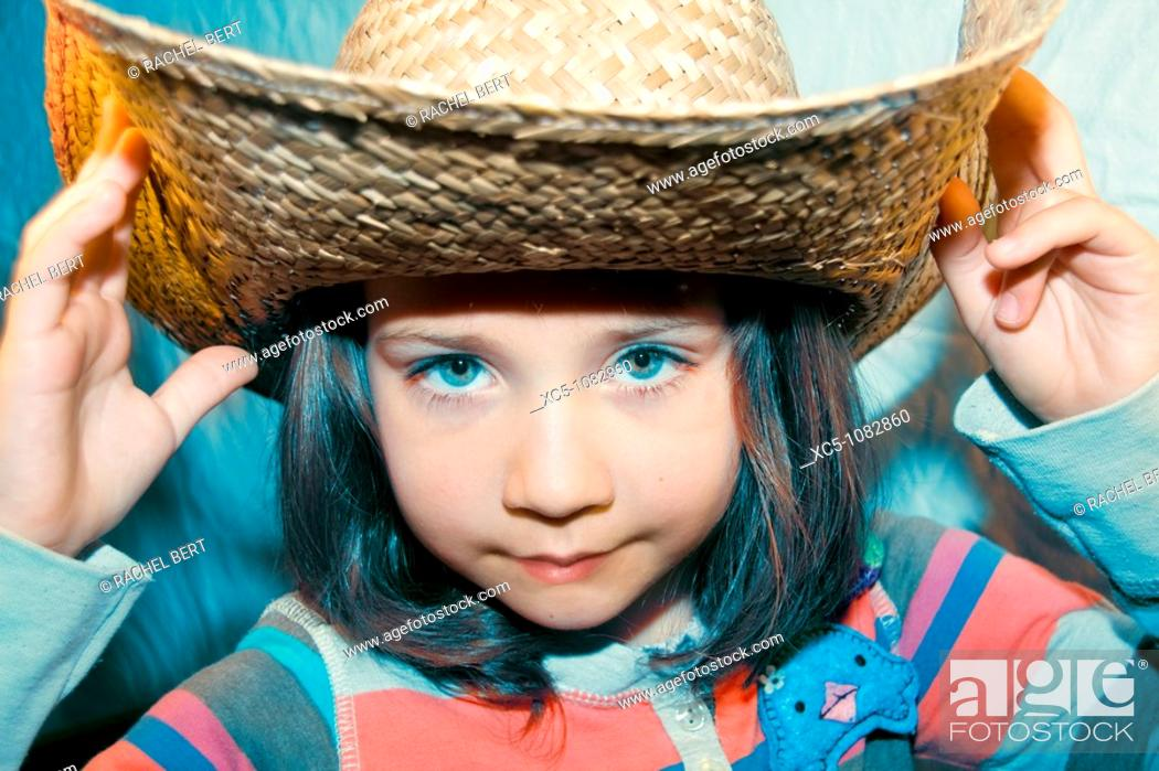 Stock Photo: 7 years old girl with straw hat.