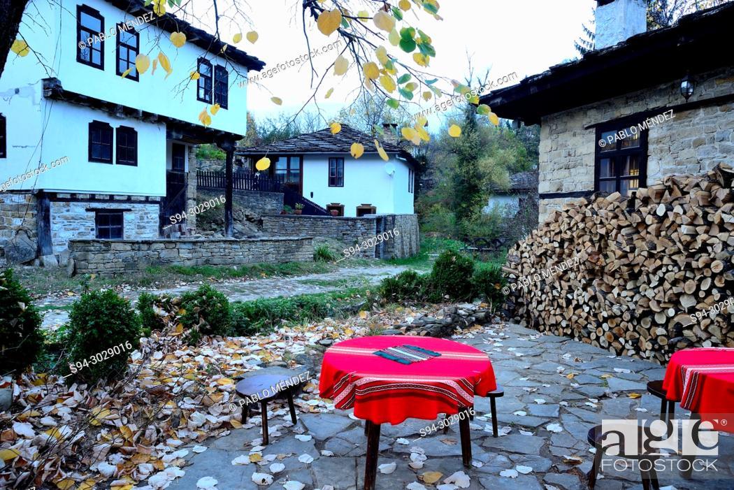 Stock Photo: Traditional houses and street of Bojentsi, Bulgaria.