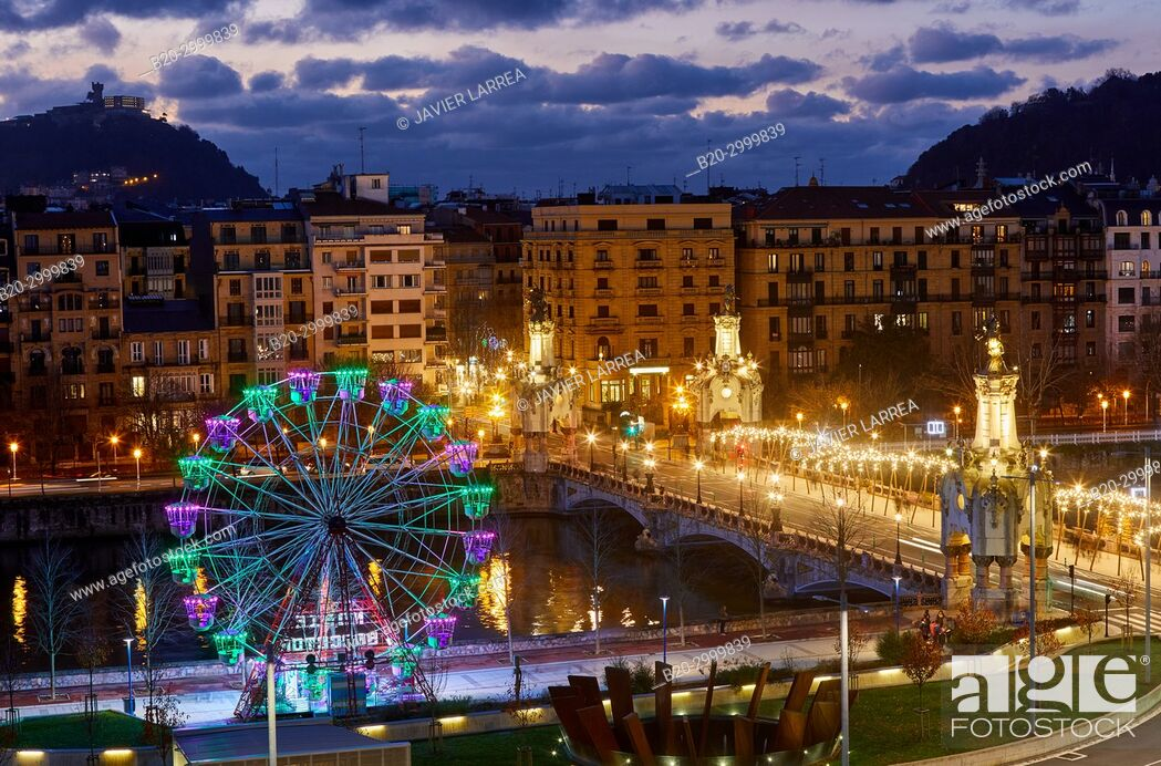 Imagen: View of the city from Tabakalera, Maria Cristina Bridge, Ferris wheel, Christmas, Donostia, San Sebastian, Gipuzkoa, Basque Country, Spain, Europe.
