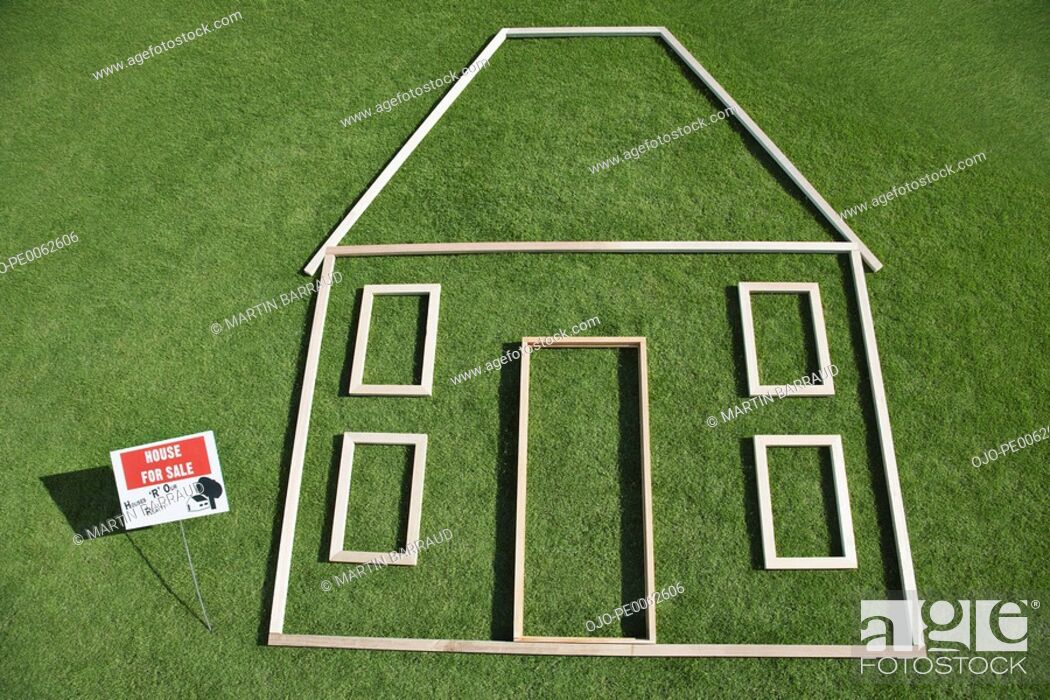 """Stock Photo: """"For sale"""" sign and house outline in grass."""