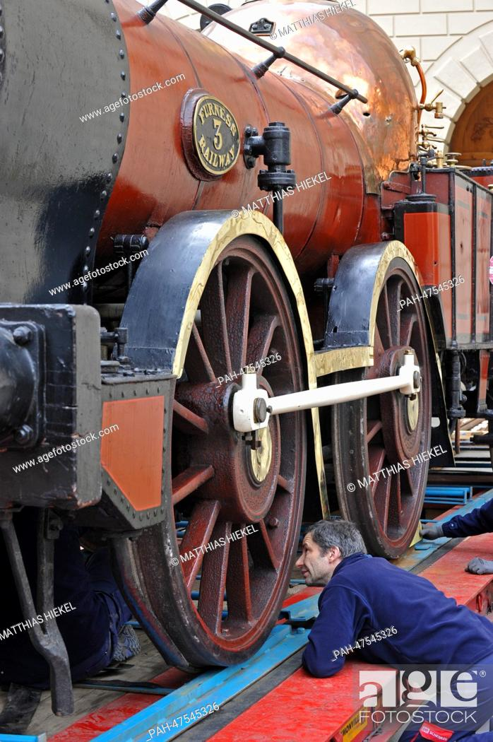 Stock Photo: Specialists unload historic steam engine 'Old Coppernob', which is on loan from the National Railway Museum in York (England).