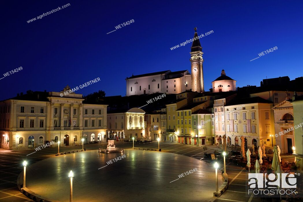Stock Photo: Empty Tartini Square in Piran Slovenia with City Hall, Tartini statue, St. George's Parish Church with baptistry, and St Peter's church at dawn.