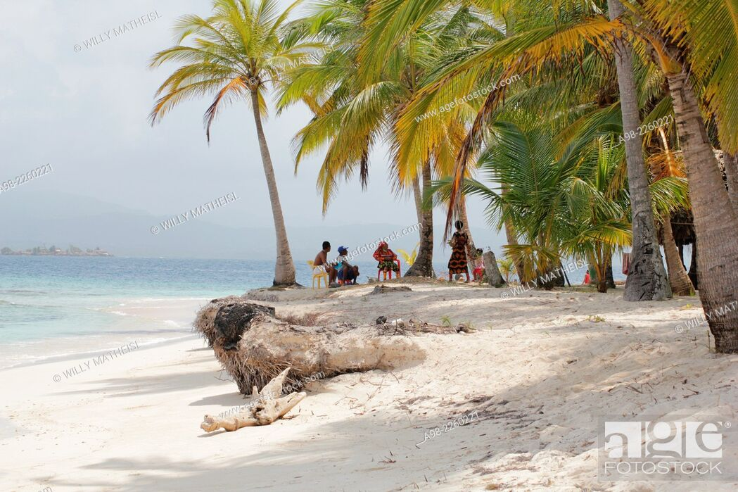 Stock Photo: Group of Kuna Indians sitting in the palm grove on the sandy beach of San Blas Islands, Panama, Central America.