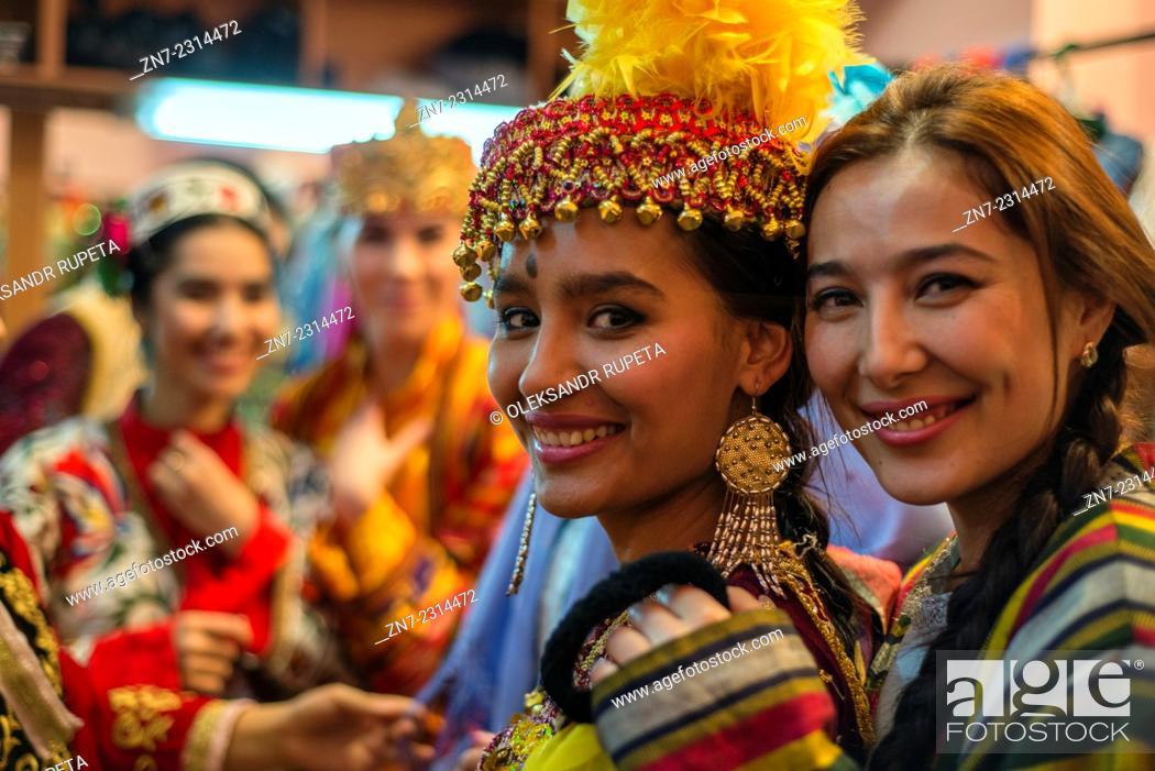 "Stock Photo: Portrait of actresses in traditional Uzbek costumes of 19 century after """"Instants of Eternity"""" show in theater of historical costume """"El Merosi"""", Samarkand."
