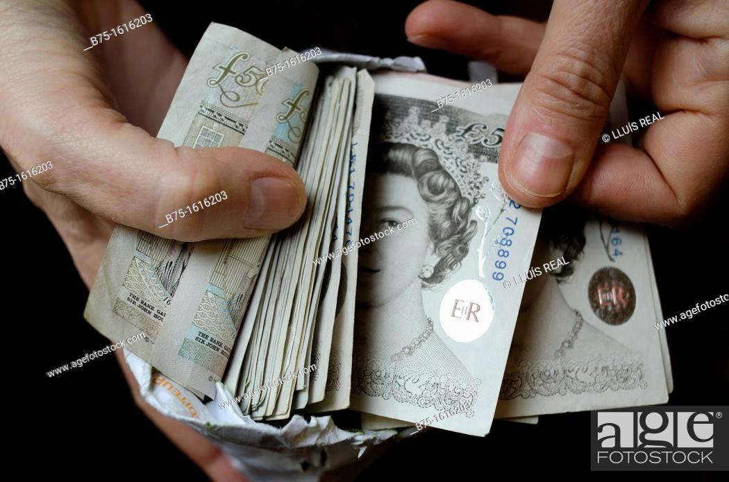 Stock Photo: sterling pounds in the hands.