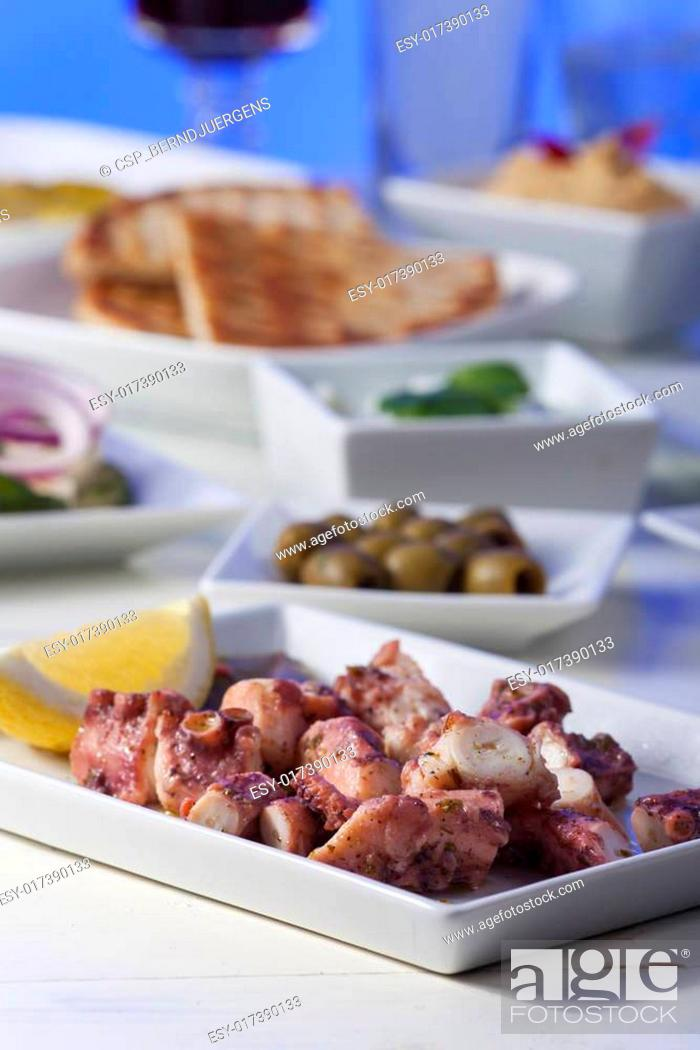 Stock Photo: greek octopus salad with a lemon.