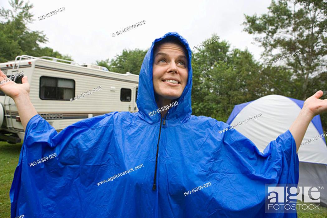 Stock Photo: Woman wearing a blue plastic raincoat.