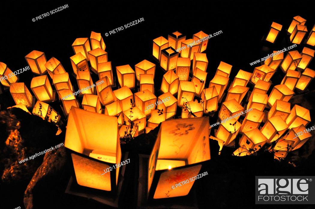 Stock Photo: Bologna (Italy): paper lanterns floating in the Giardini Margherita's lake after sunset, to commemorate Hiroshima atomic bomb's massacre (August 6th).