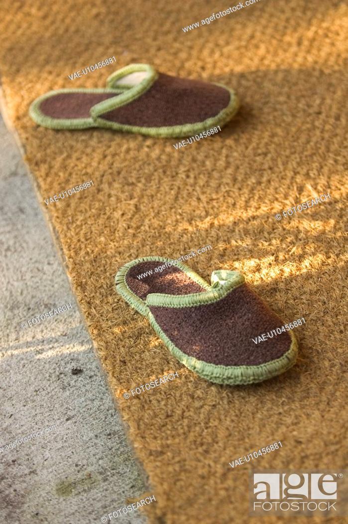Stock Photo: Carpet, Close-Up, Footwear, Indoors.