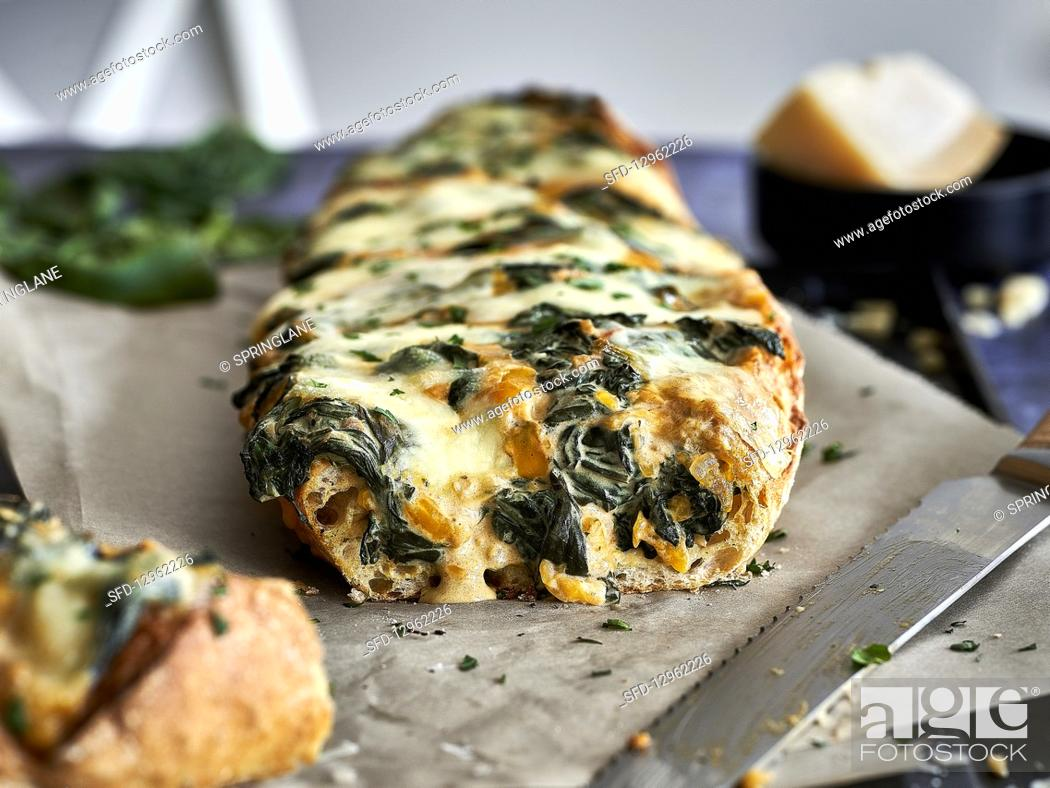 Stock Photo: Gratin spinach and cheese baguette.