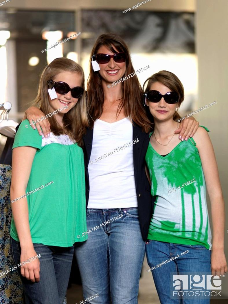 Stock Photo: Mother and two girls shopping.