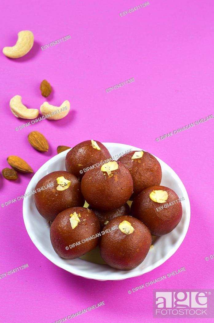 Stock Photo: Indian Dessert : Gulab Jamun in white bowl.