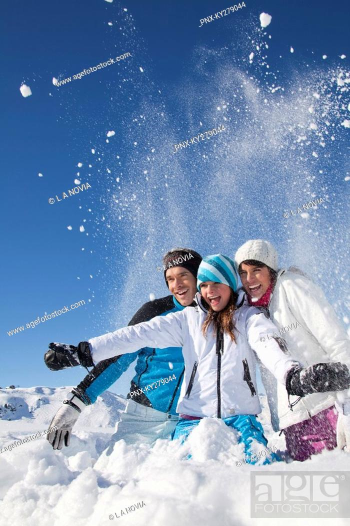 c70f267214 Stock Photo - Couple and daughter in ski wear