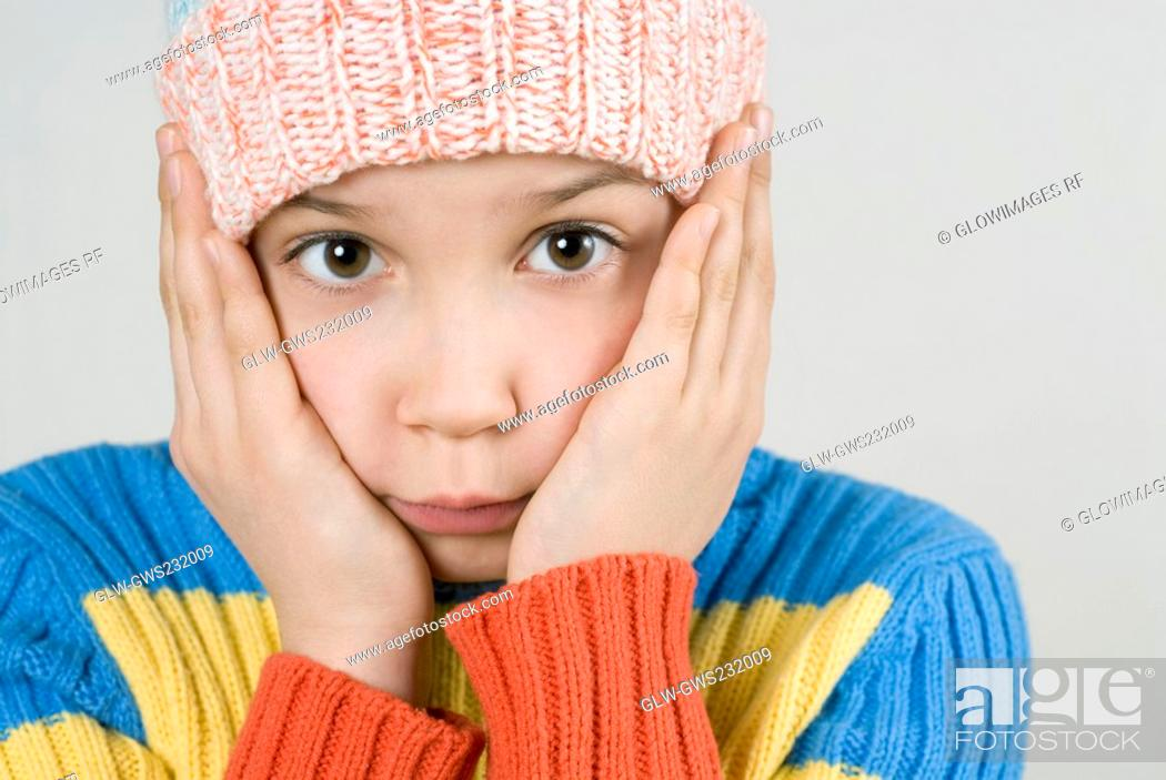 Stock Photo: Close-up of a girl thinking and puckering.