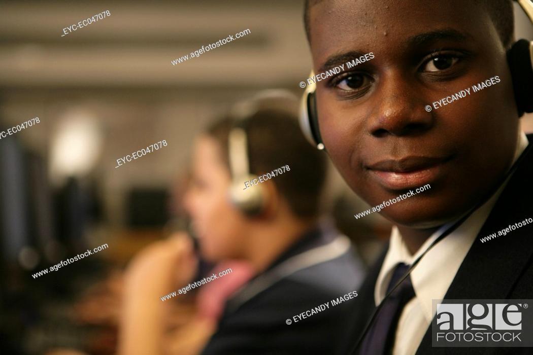 Stock Photo: Boy 11-13 wearing headphones, portrait.