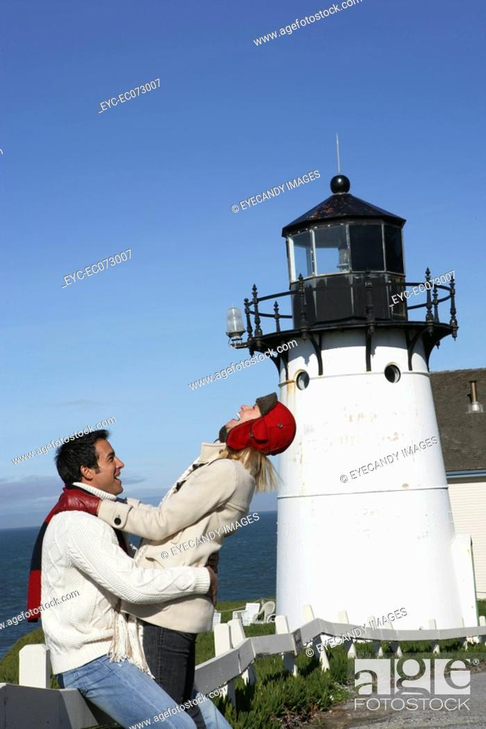 Stock Photo: Happy couple at lighthouse.