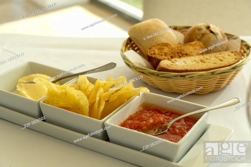 Stock Photo: Fresh bread in the basket with potato chips on table in restaurant Spain.