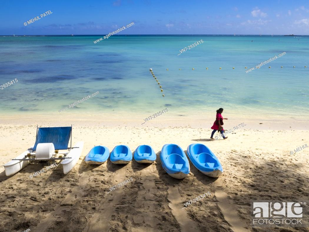 Stock Photo: Pedalo and canoes on Mont Choisy beach, Mauritius, Indian Ocean.