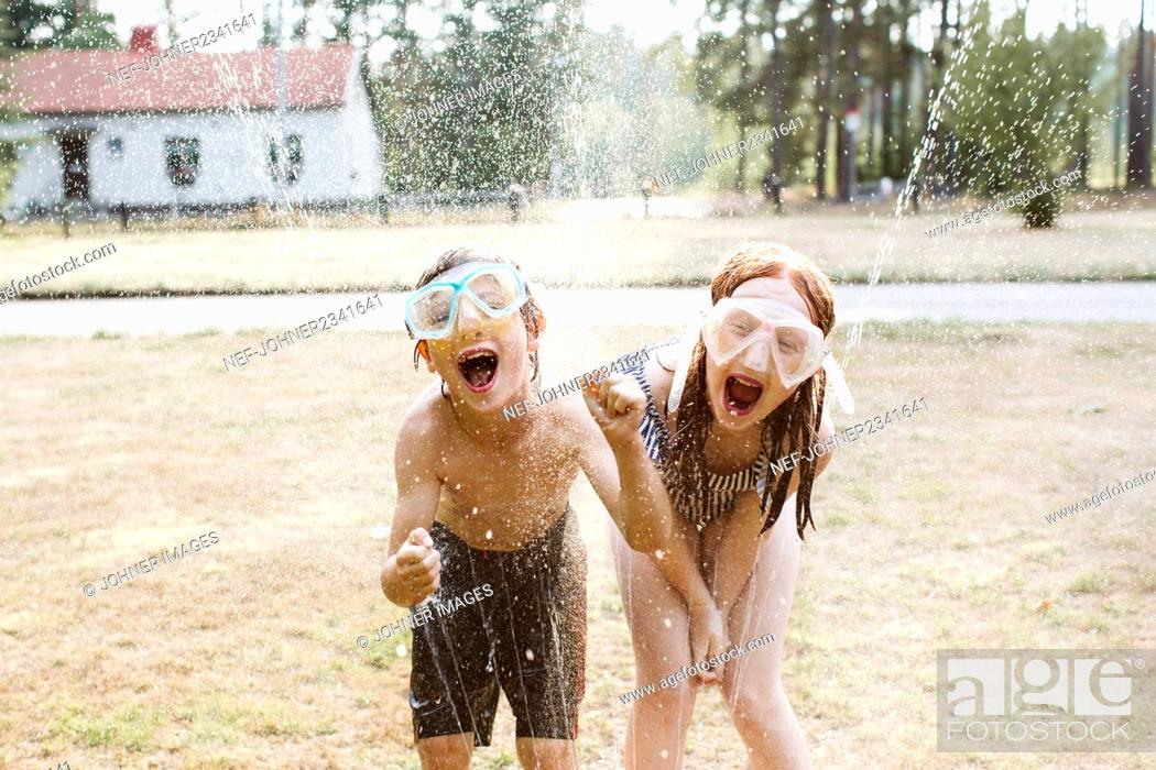 Stock Photo: Cheerful kids playing with water.