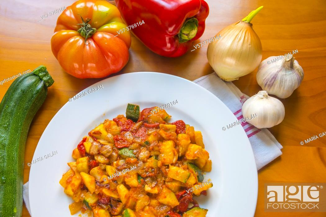 Stock Photo: Pisto with some ingredients. Spain.