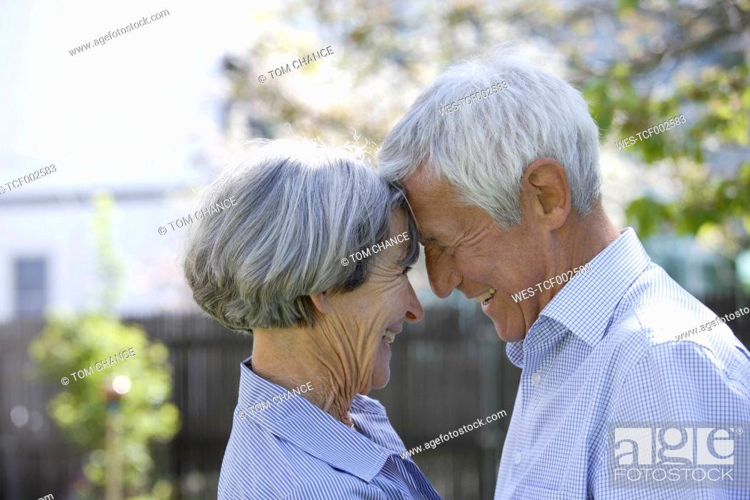 Stock Photo: Germany, Bavaria, Senior couple looking at each other, smiling.
