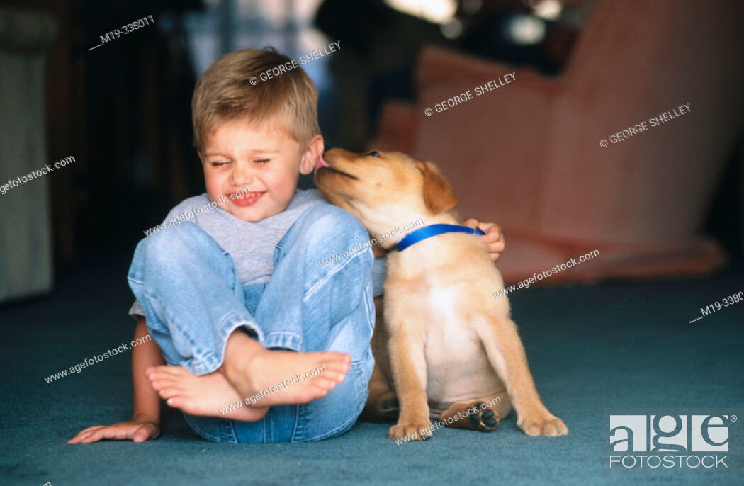Stock Photo: kid with his loving puppy.