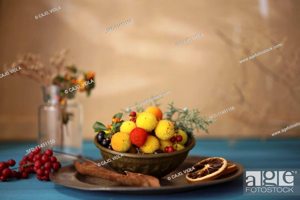 Stock Photo: Various winter fruits in a metal bowl.
