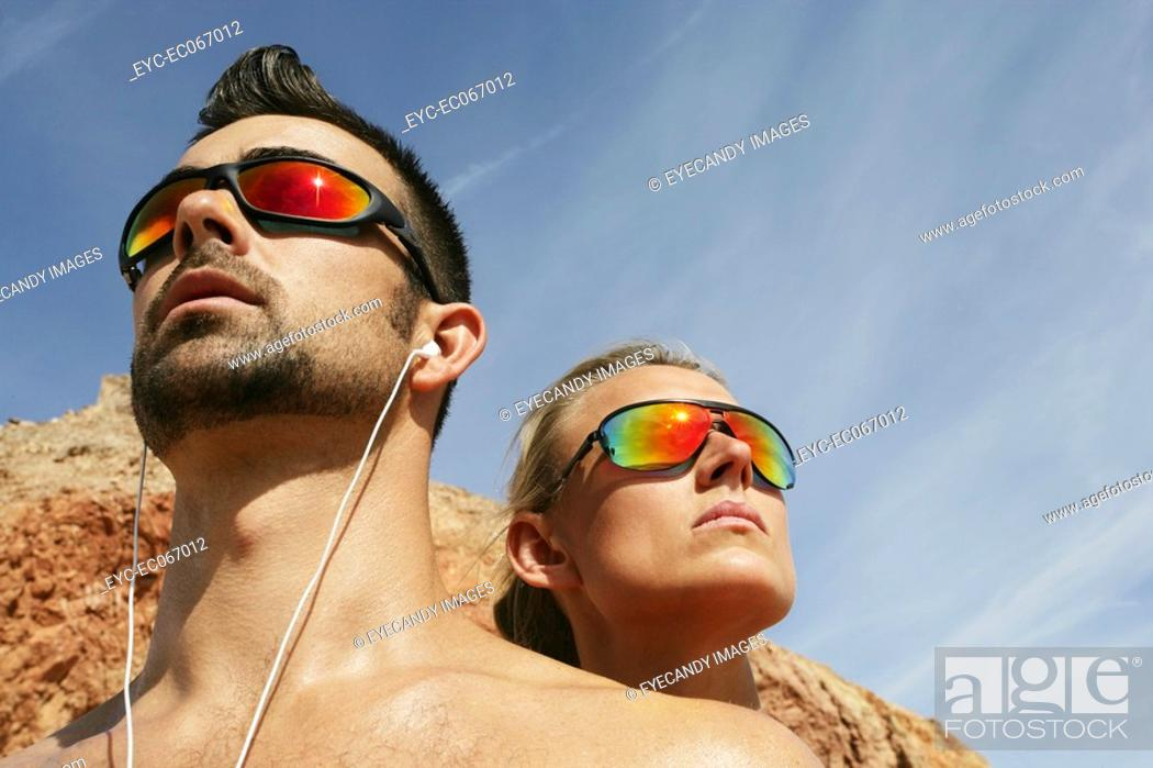 Stock Photo: Two people wearing shades outdoors.