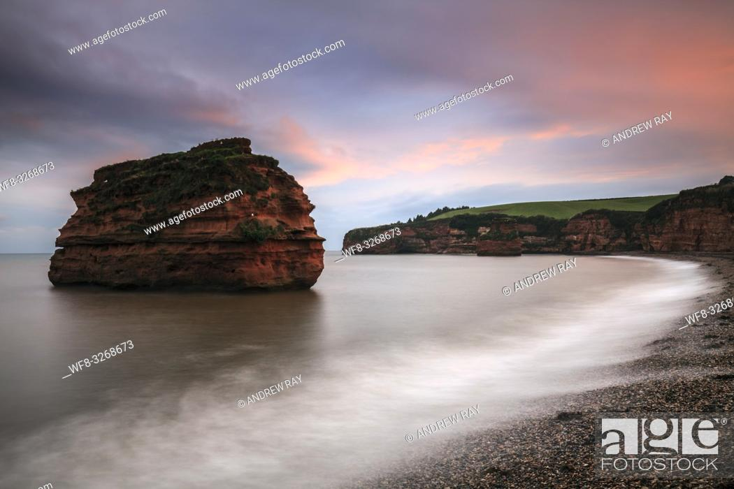 Stock Photo: A sandstone sea stack at Ladram Bay near Sidmouth in South East Devon, captured at sunset in mid September.