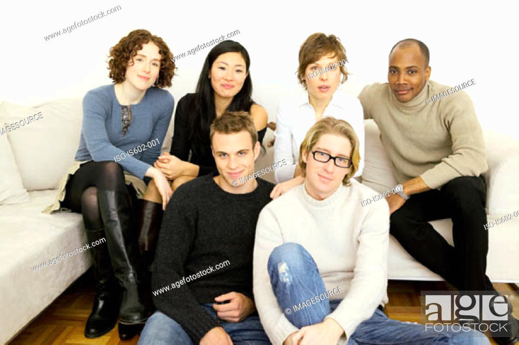 Stock Photo: Portrait of friends on sofa.
