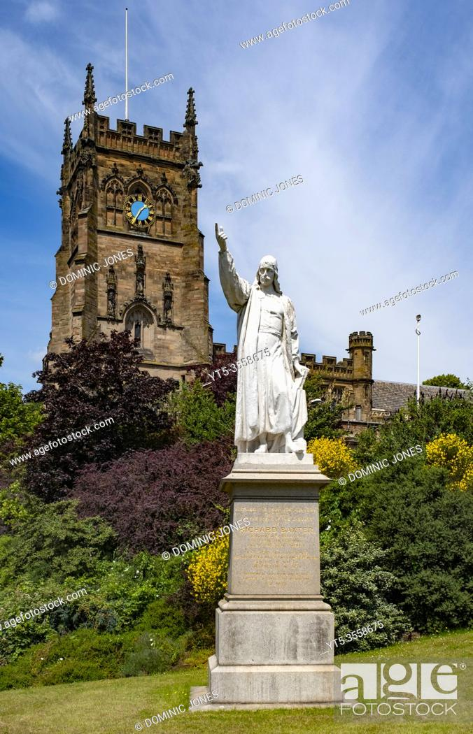 Stock Photo: The statue of Richard Baxter in front of St Marys Church in Kidderminster.