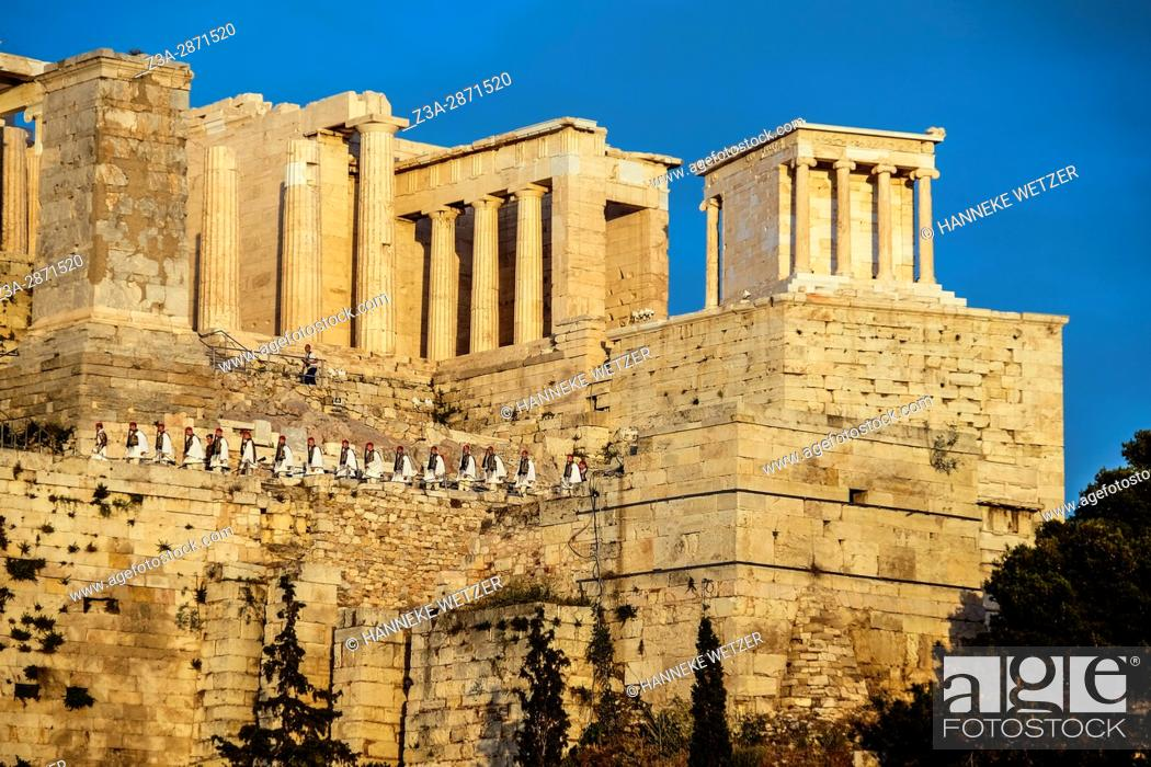 Stock Photo: The Greek Presidential Guard walking onto the acropolis to get the flag, seen from the Areopagus hill, Greece.