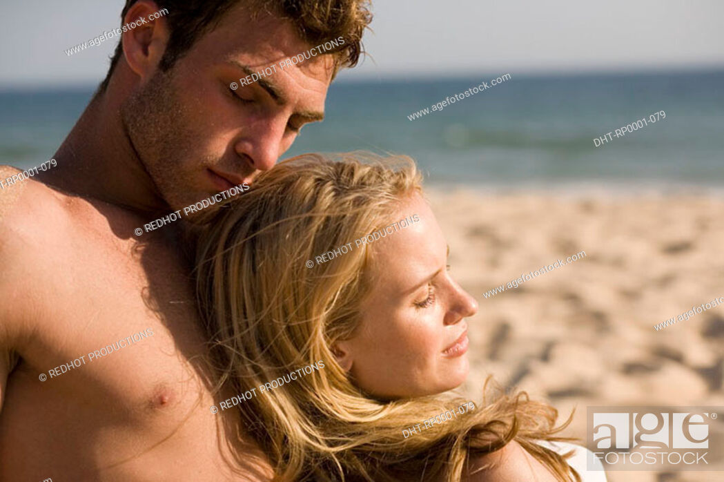 Stock Photo: Young couple on beach.