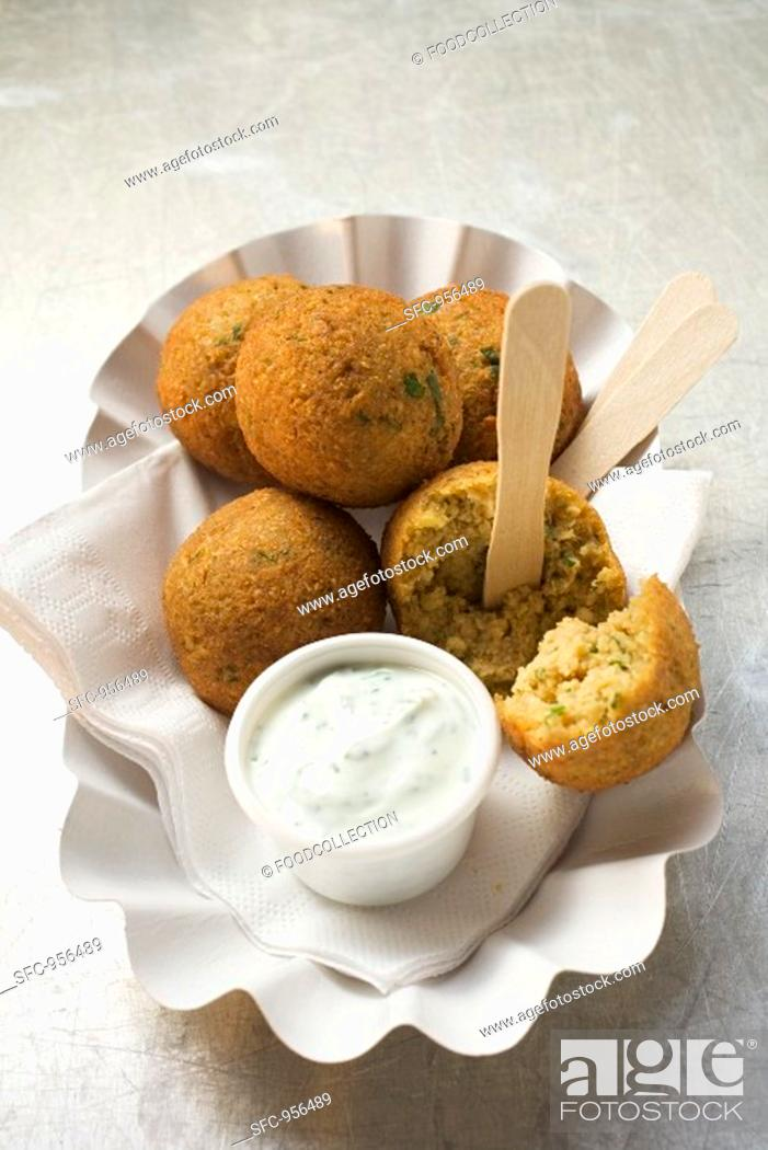 Stock Photo: Falafel chick-pea balls with yoghurt dip.