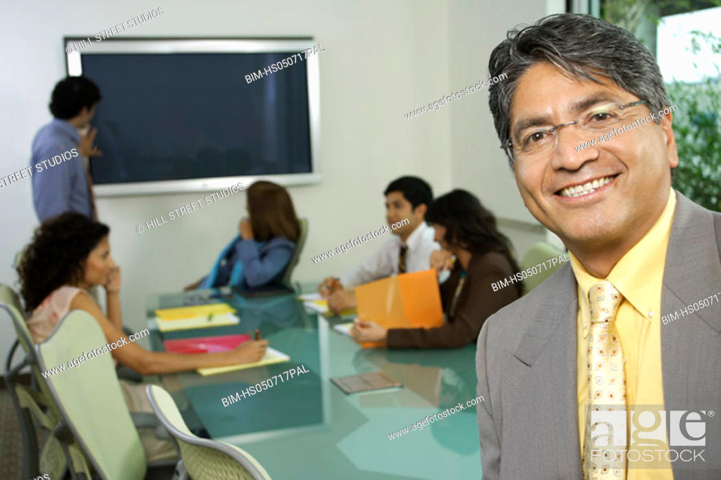 Stock Photo: Businessman smiling for the camera.