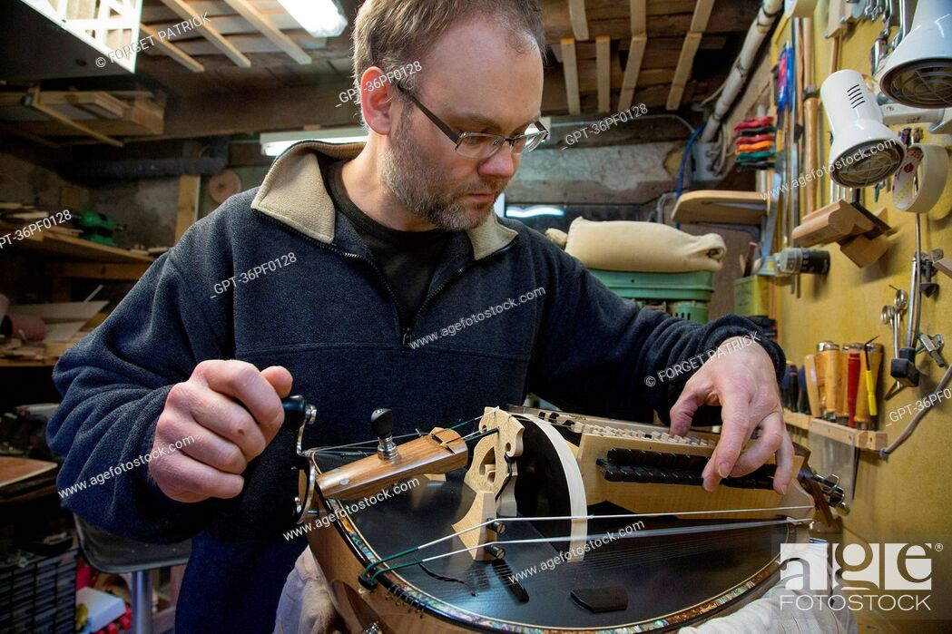Stock Photo: SEBASTIEN TOURNY, MAKER OF HURDY-GURDIES, LA CHATRE (36), GEORGE SAND'S BLACK VALLEY IN THE BERRY, FRANCE.