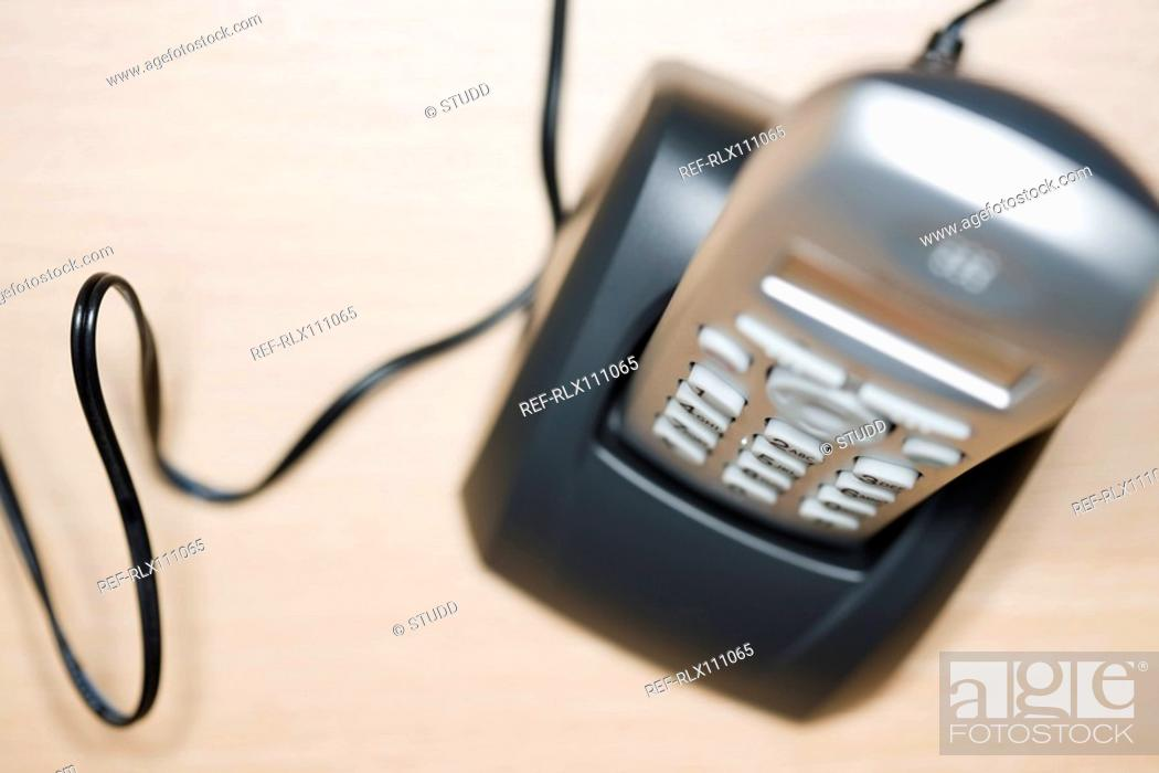 Stock Photo: Overhead view of phone on base station.