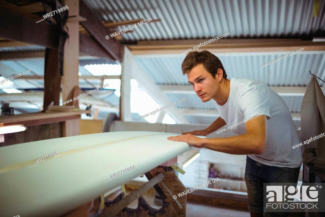 Stock Photo: Man making surfboard.