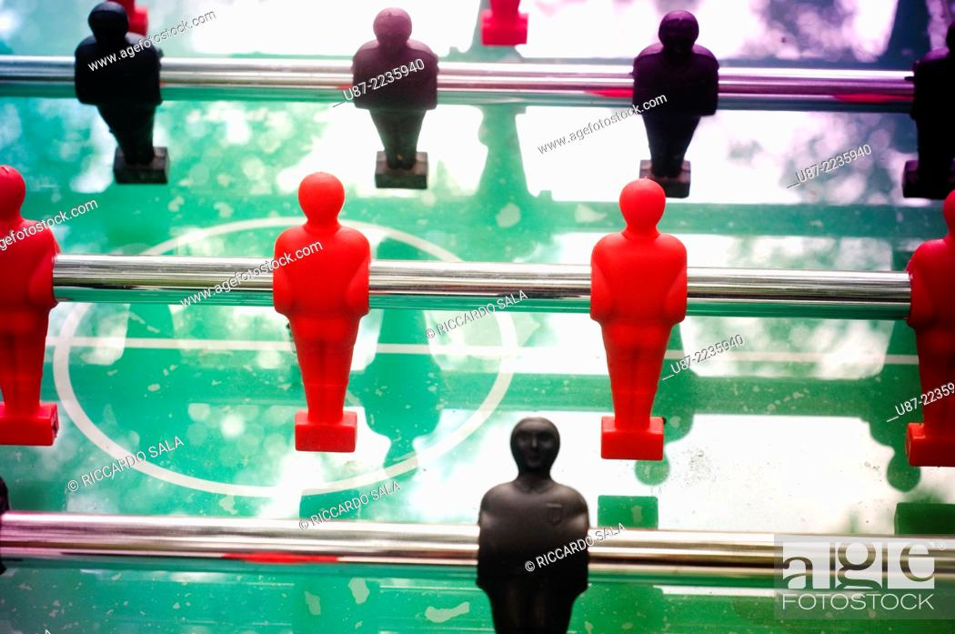 Stock Photo: Foosball Table with Red and Black Figures.