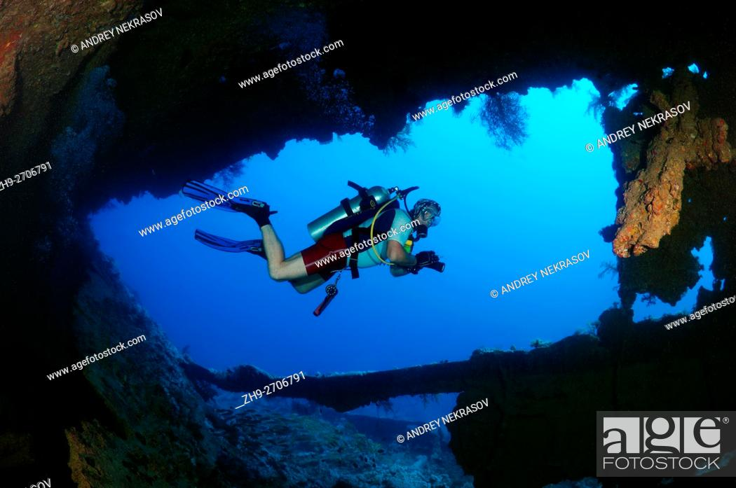 Stock Photo: Male scuba diver inside the wreck of the SS Dunraven, Red Sea, Egypt.