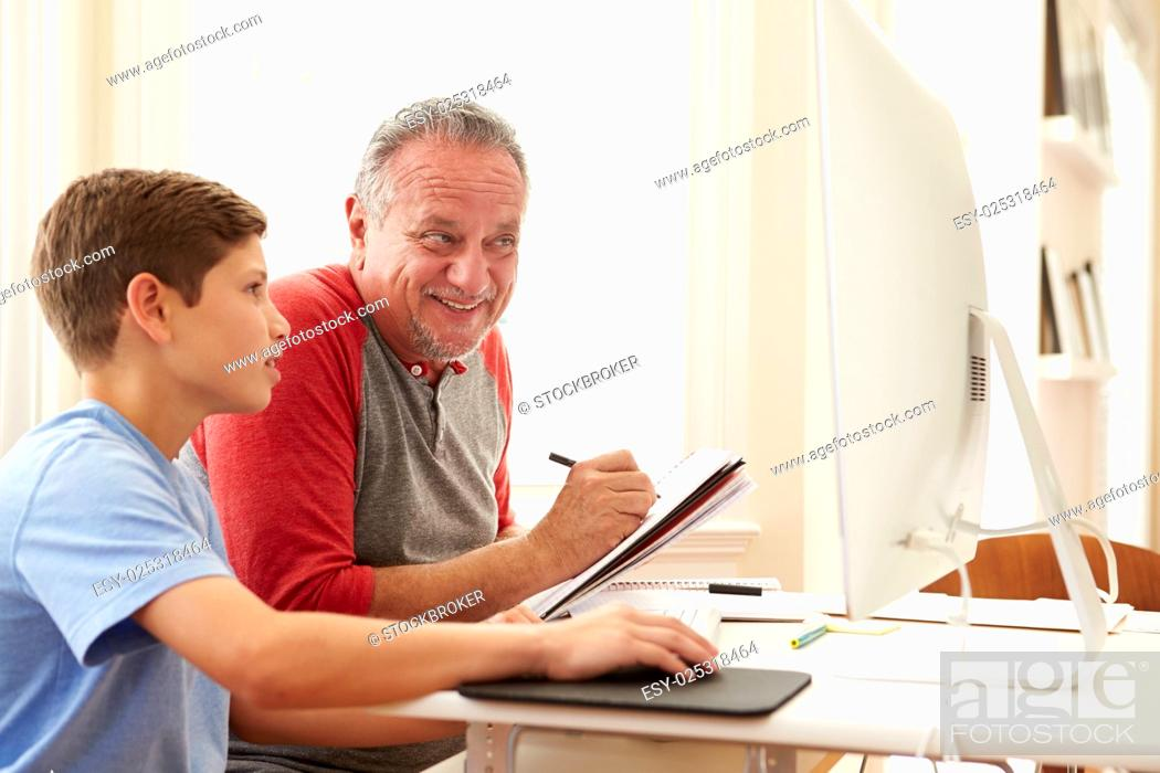 Stock Photo: Grandson Teaching Grandfather To Use Computer.