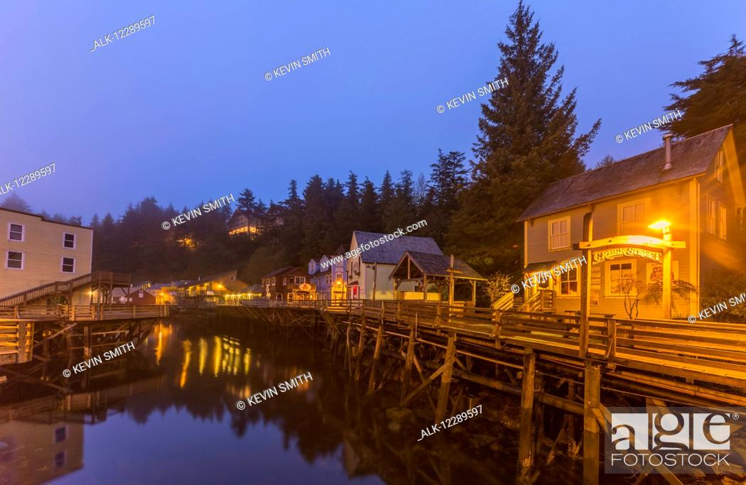 Stock Photo: Tourist shops and homes along Creek Street in downtown Ketchikan on a foggy evening, Southeast Alaska, USA, Spring, HDR.