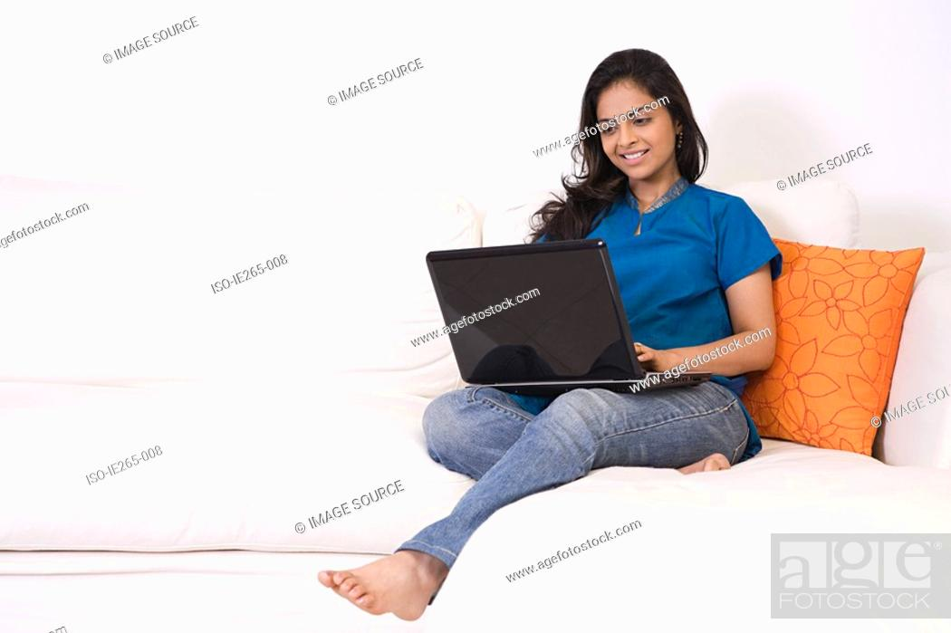 Stock Photo: A young woman using a laptop.