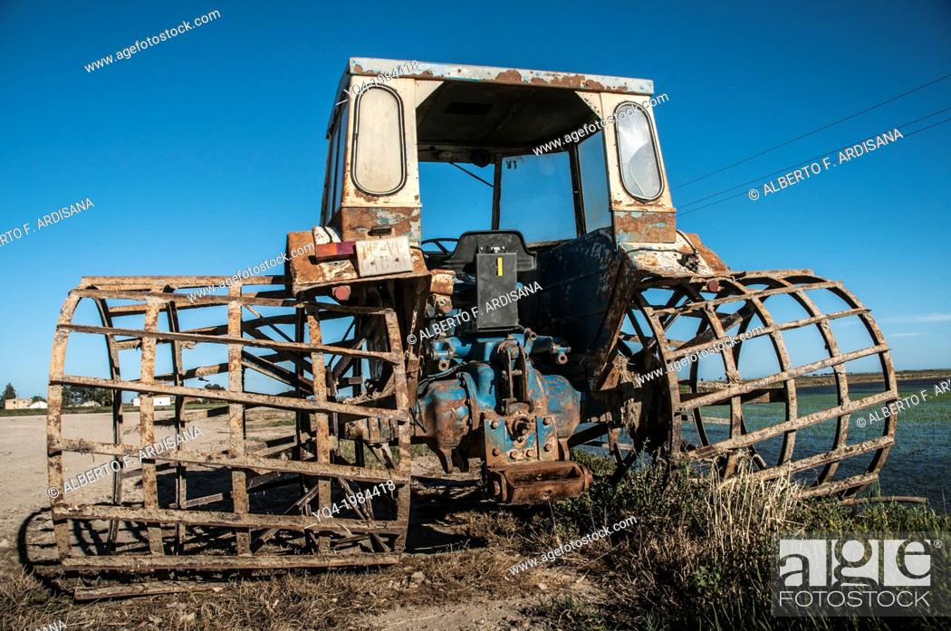 Stock Photo: Tractor with special wheels to work in the rice fields, Ebro Delta, Catalonia, Spain.